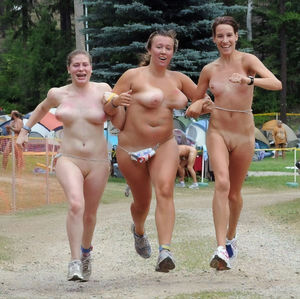 Old and young nudists playing sport..