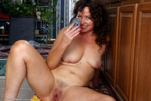 Mature Candy toying her hairy snatch..