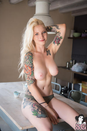 Blue eyed tattooed angel with natural..