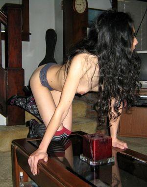 Naughty asian wife posing in black..