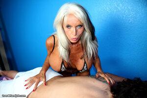 Older lady uncorks her massive boobs..