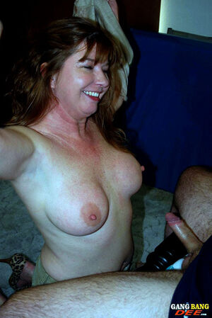 Horny mature Dee gets on her knees..