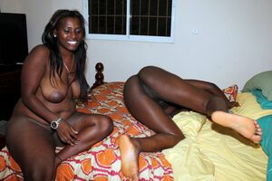 Cheerful black girlfriends with big..