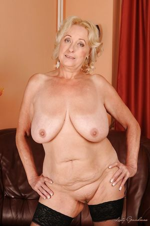 Blonde granny in stockings slipping..