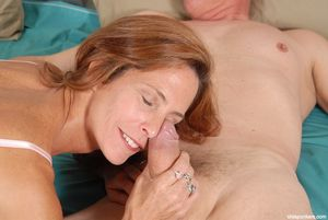 Stunning redhead mature Sherry gives a..