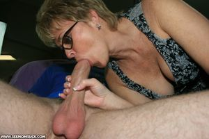 Short haired mature blonde in glasses..