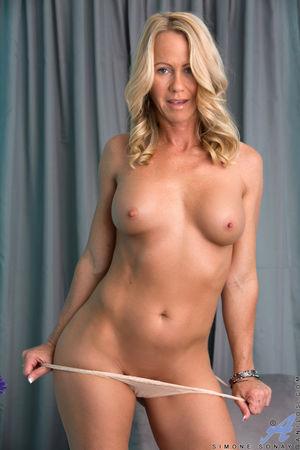 Leggy blonde MILF showing off nice ass..