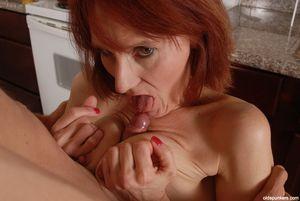 Mature redhead Debra gives blowjob and..