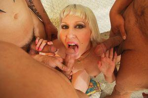 Mature mom Dalny Marga takes on a trio..