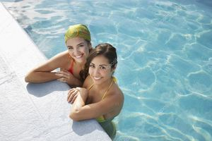 Girls in swimming pool - Stock Photo..