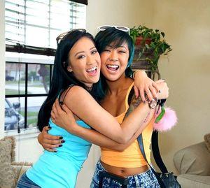 Two young asian beautiful girls in..