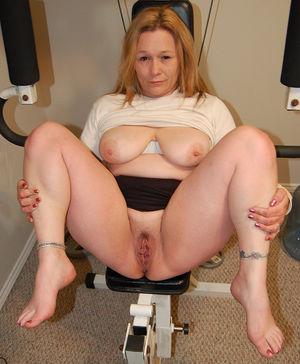 Blonde mom posing on the exerciser -..