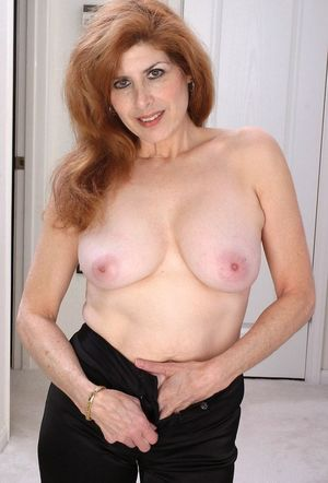 Sexy mature redhead spreads pussy -..