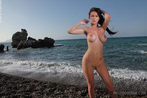 Corinne posing naked near secret beach..