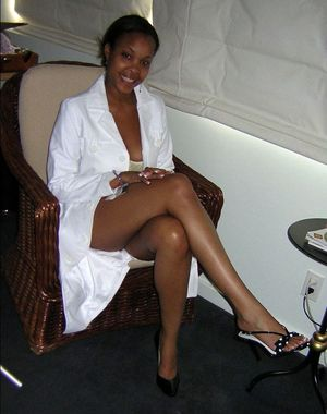 Leggy african slut-wife with a tattoo..