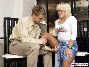 Blonde MILF in stockings fucks with..