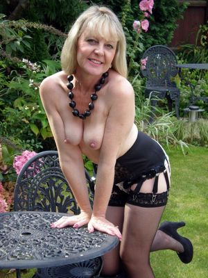 My charming mature wife posing topless..